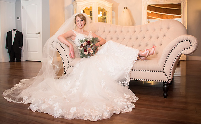 Photo shoot inside our bridal boutique courtesy of High Contrast Photography (https://highcontrastphotography.net/). Our model wears a gown by Mon Cheri Bridal and veil by Richard Designs of Britain. Schedule your appointment today to find your dream dress! Call 443.502.8471.